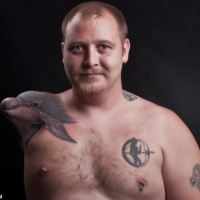 The Man With The Dolphin Stump Tattoo [PHOTO]