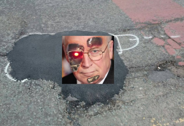 wanksy spray paint pothole