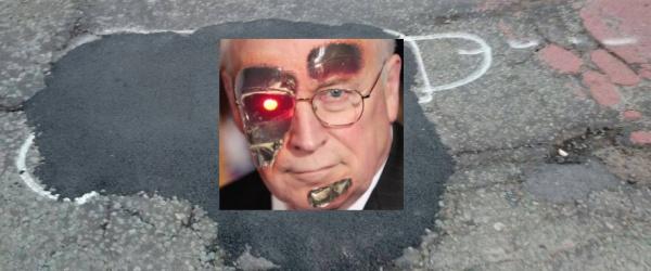 wanksy spray paint pothole