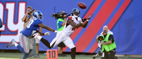 Atlanta Falcons wide receiver Julio Jones, right, makes a catch near the end zone on a pass from quarterback Matt Ryan, not pictured, as New York Giants cornerback Prince Amukamara defends on the play during the second half of an NFL football game, Sunday, Sept. 20, 2015, in East Rutherford, N.J.