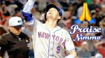 New York Mets outfielder Brandon Nimmo points to the heavens after scoring a run.