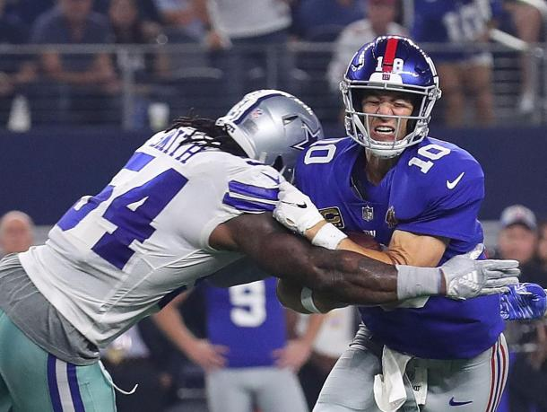 New York Giants quarterback Eli Manning gets crushed by Dallas Cowboys linebacker Jaylon Smith.