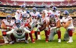 The New York Giants offense celebrates after a passing touchdown from Eli Manning to Benny Fowler in their blowout win against the Washington Redskins in NFL Week 14.